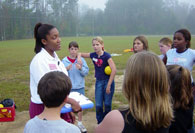 Intern teaching students on soccer field