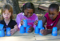 Girls stacking cups